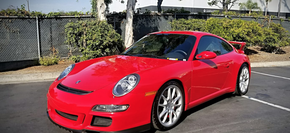 Red Porsche after a ceramic coating maintenance wash by 5 Point Auto Spa in Carlsbad, CA.