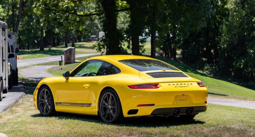 Yellow Porsche with Ceramic Pro paint coating installed on it for superior paint protection.