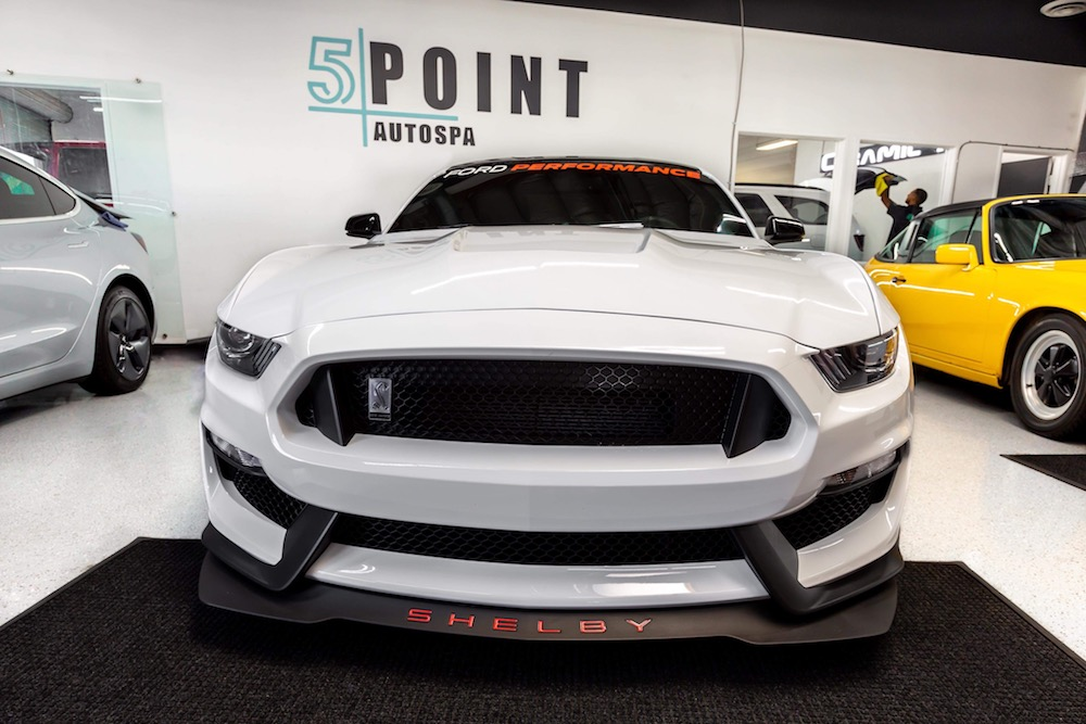 White Ford Shelby in the garage of 5 Point Auto Spa. The Shelby just received a clear bra package with a clear bra warranty.